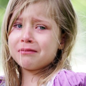 Blonde little girl crying